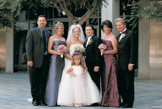 portrait-of-newlyweds-with-family-and-friends