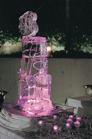 purple-and-pink-lit-ice-sculpture-and-ice-cubes
