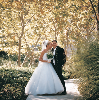 hawaiian-groom-attire-and-brides-ball-gown