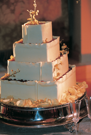 square-white-cake-decorated-with-gold-leaves