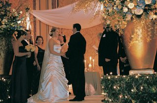 bride-and-groom-stand-under-chuppah