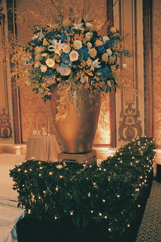 huge-gold-vase-of-blue-white-and-gold-flowers