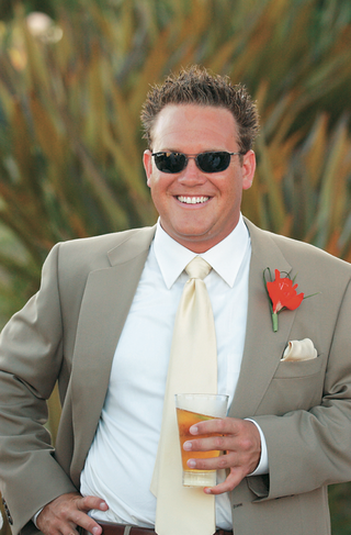 groom-with-ray-ban-sunglasses-and-drink-in-hand
