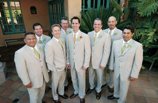 groom-with-seven-groomsmen-in-khaki-suits-and-green-ties