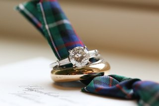 gold-mens-wedding-band-and-round-cut-diamond-engagement-ring-with-side-stones-on-plaid-invitation
