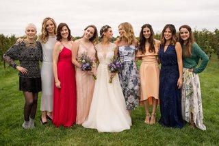 brides-in-a-line-wedding-dress-with-friends-bridesmaid-best-friends-mismatched-dresses-vineyard