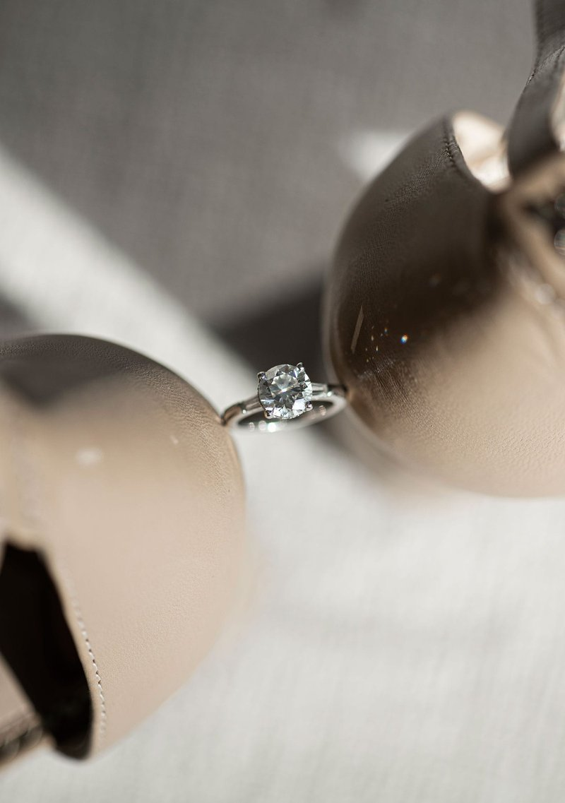 Solitaire Engagement Ring Between Shoes