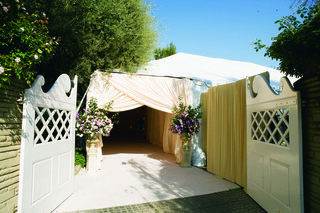 garage-doors-opened-to-light-pink-tent