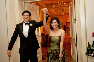 bride-and-groom-entering-ballroom-reception
