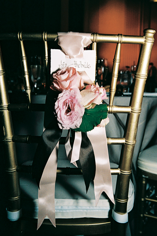 gold-chair-with-ribbon-and-flower-decoration