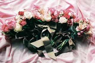 pink-and-ivory-flowers-tied-with-brown-ribbons