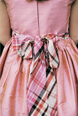 pink-dress-with-brown-and-red-checkered-ribbon