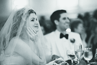 black-and-white-image-of-bride-in-veil-at-reception