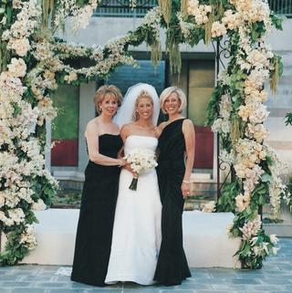 bride-and-mother-under-floral-chuppah
