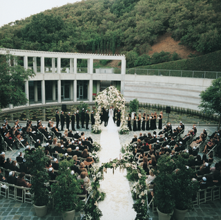 ceremony-in-museum-courtyard-with-mountain-background