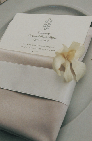 menu-card-and-napkin-decorated-with-white-flower