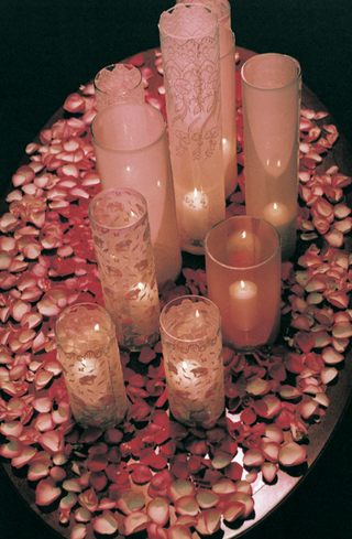 table-covered-with-pink-petals-and-candles