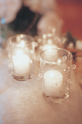 white-candles-in-glass-votives