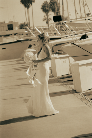 black-and-white-bride-with-sailboats-in-background
