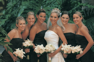 bride-with-bridesmaids-in-black-strapless-dresses