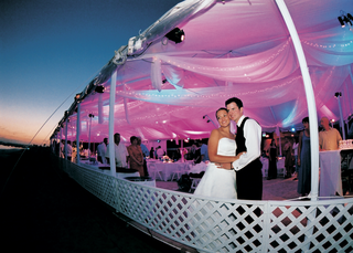 white-tent-in-front-of-sunset-with-pink-and-purple-lighting