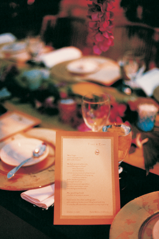 orange-and-white-menu-on-reception-table