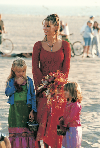 flower-girls-and-bridesmaid-at-beach-ceremony