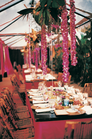 bamboo-chairs-and-floral-garlands-decorate-a-rustic-reception
