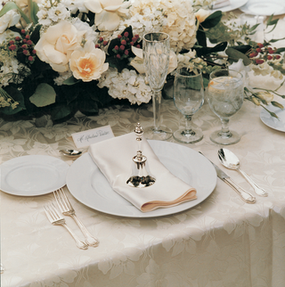 off-white-place-setting-and-flowers