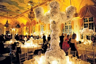 wedding-centerpiece-with-white-flowers-over-tall-candelholder