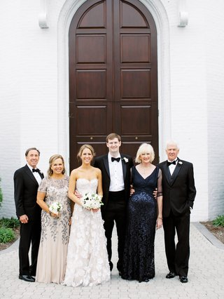bride in mira zwillinger wedding dress mother of bride and groom in blue accent dresses tuxedos for dads