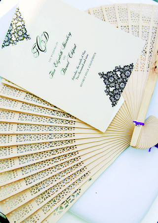 ceremony-booklet-on-intricate-wooden-fan