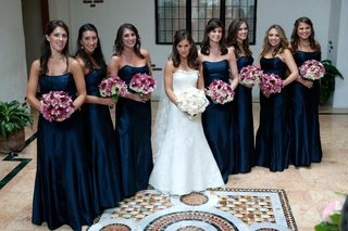bride-with-bridesmaids-in-navy-blue-strapless-gowns