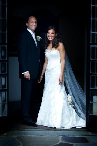 bride-in-two-piece-wedding-dress-with-groom