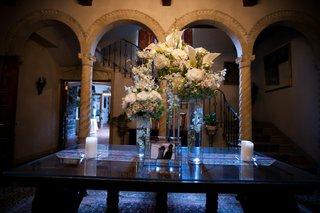 white-flower-arrangement-at-wedding-reception-entrance