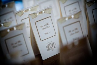 white-and-gold-escort-cards-with-monogram-and-bow