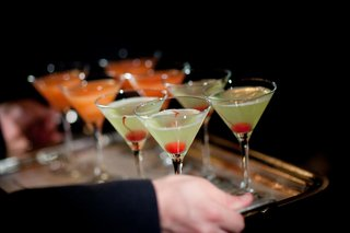 light-green-martini-with-red-cherry-and-orange-martinis