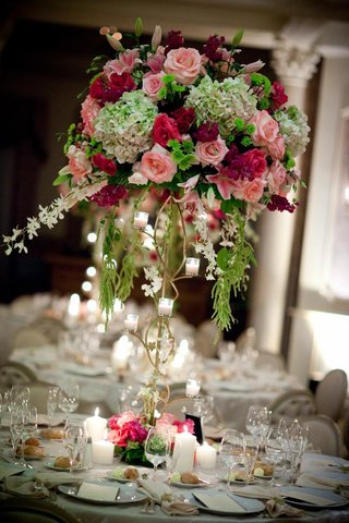 indoor-wedding-reception-flower-arrangement-with-gold-stand
