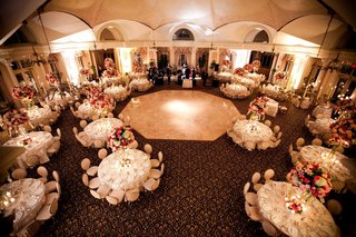 reception-room-shot-of-round-tables-around-dance-floor