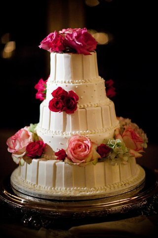 white-cake-with-stripes-dots-and-fresh-pink-flowers