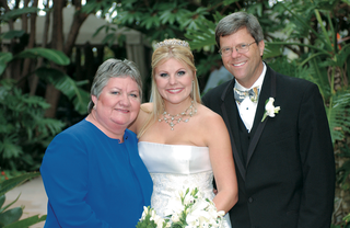 the-bride-with-her-parents-after-ceremony