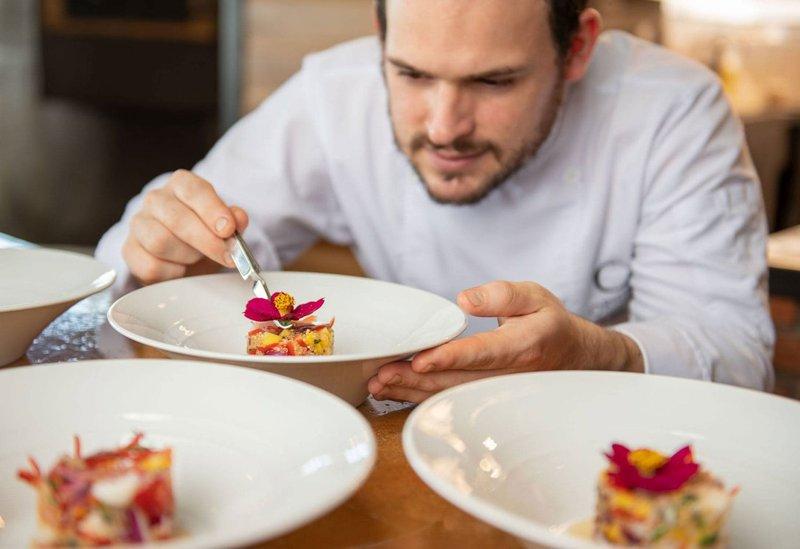 ORIGINS Luxury Lodge - Chef Preparing Meals