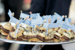 miniature-cheeseburgers-with-light-blue-flags