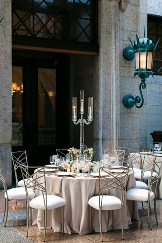 crystal-candelabra-with-three-candles-neutral-linens-chameleon-chairs