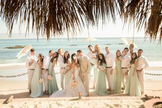 katrina-hodgson-and-groom-with-bridesmaids-and-groomsmen-on-beach