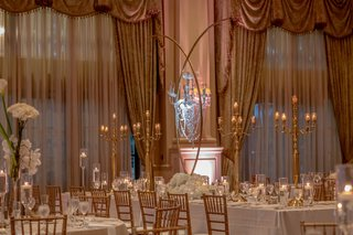 country-club-wedding-reception-drapery-valance-tall-gold-centerpiece-candelabra-white-flowers-candle