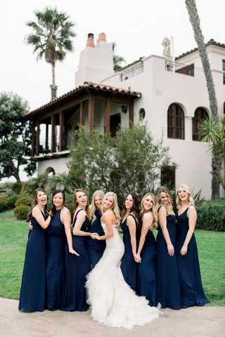 bride-in-strapless-mermaid-wedding-dress-with-bridesmaids-in-navy-blue-dresses-mismatch-necklines