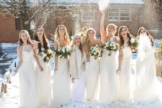 bridesmaids-in-cream-amsale-gowns-throw-snowballs