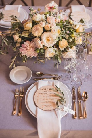 rustic-wedding-reception-place-setting-lavender-linen-centerpiece-freshly-picked-wood-round-menu