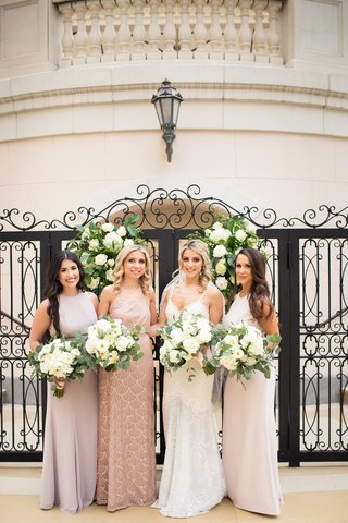 bride-in-alon-livne-dress-bridesmaids-in-mismatched-dresses-in-faint-pale-hues